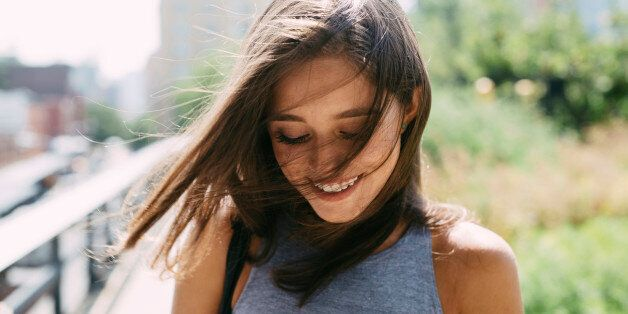 USA, New York City, smiling brunette young woman