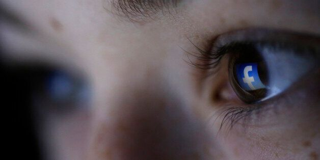 A picture illustration shows a Facebook logo reflected in a person's eye, in Zenica, March 13, 2015....
