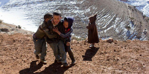 Children play in Ait Sghir village in the High Atlas region of Morocco February 14, 2015. The snowy foothills...