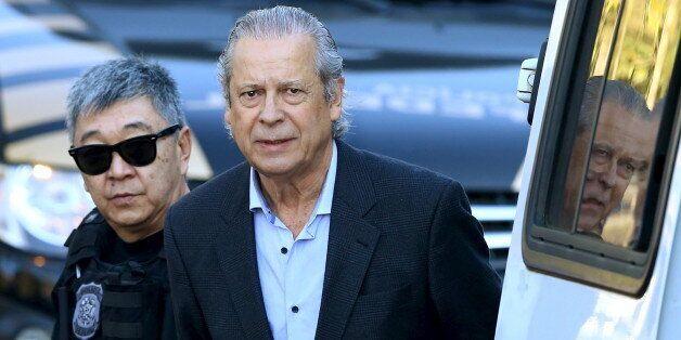 Jose Dirceu (R), former Brazilian President Luiz Inacio Lula da Silva's chief of staff, is escorted by...