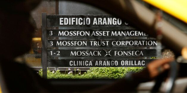A taxi pass a company list showing the Mossack Fonseca law firm at the Arango Orillac Building in Panama...
