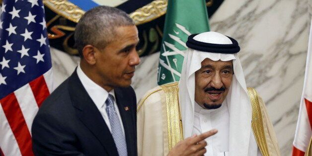 U.S. President Barack Obama (L) gestures as he stands next to Saudi Arabia's King Salman during the summit...