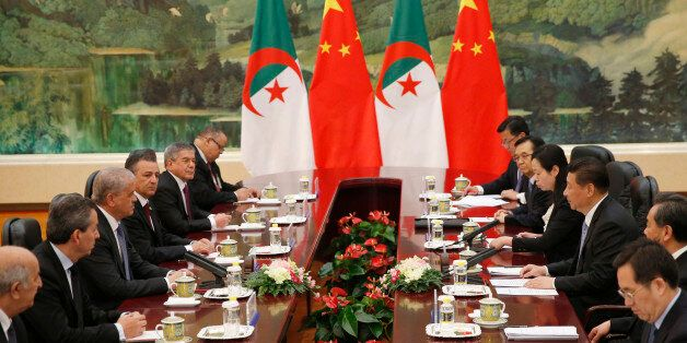 Algeria's Prime Minister Abdelmalek Sellal, third left, shakes hands with Chinese President Xi Jinping,...