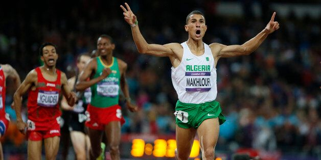 Algeria's Taoufik Makhloufi (front) celebrates as he wins the men's 1500m final during the London 2012...
