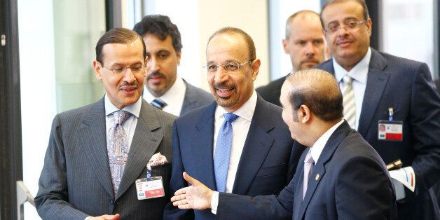 Saudi Arabia's Energy Minister Khalid al-Falih (C) arrives for a meeting of OPEC oil ministers in Vienna,...