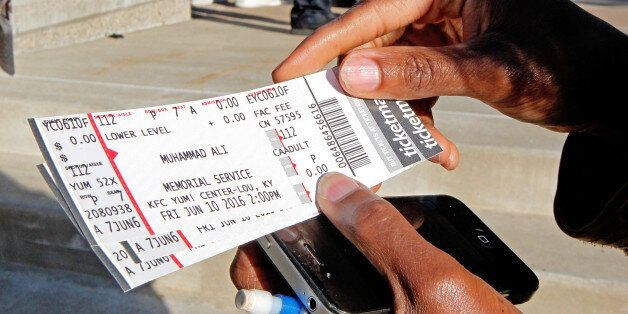 Fay Brents looks over her four tickets to Muhammad Ali's Friday memorial service at the KFC Yum! Center...