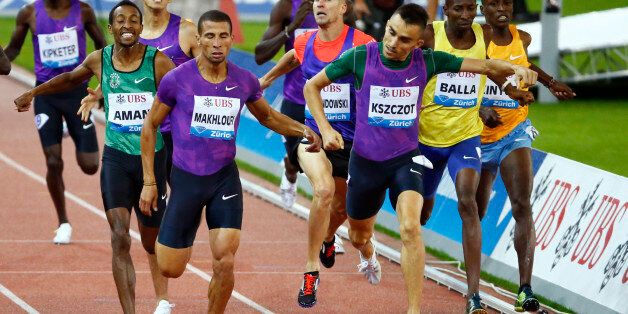 Adam Kszczot of Poland and Taoufik Makhloufi of Algeria cross the finish line in the men's 800m event...