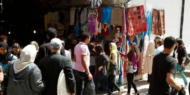 Tunisians walk at the Kasba souk in the old town of Tunisia April 2, 2012. At its factory on the outskirts...