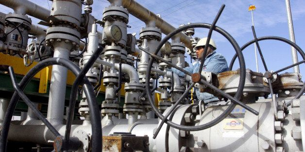 A worker checks the valves at Al-Sheiba oil refinery in the southern Iraq city of Basra, January 26,...