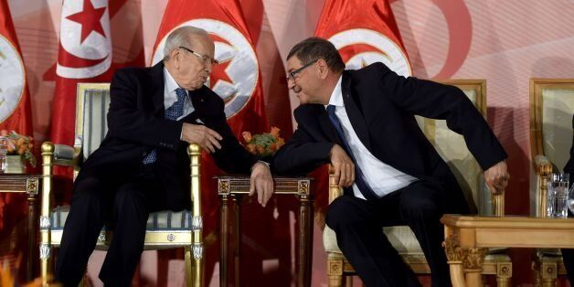 Tunisian President Beji Caid Essebsi(L) and prime minister Habib Essid attend a May Day celebration on...
