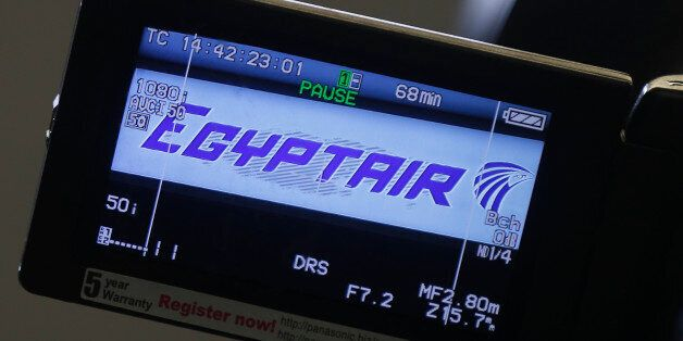 The company logo is displayed on a video camera screen at the Egyptair desk at Charles de Gaulle airport,...