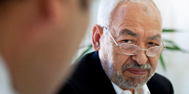 Tunisian leader and founder of the moderate islamist party Ennahda, Rached Ghannouchi, chairs an executive...