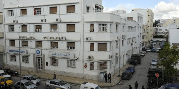 Soldiers guard on November 25, 2011 the headquarters of the Gafsa Phosphates Company (CPG) in Tunis,...