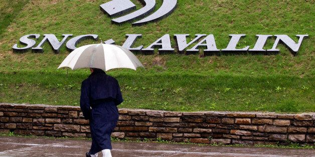 A pedestrian walks past the SNC-Lavalin Group Inc., headquarters in Montreal, May 7, 2009. SNC-Lavalin...