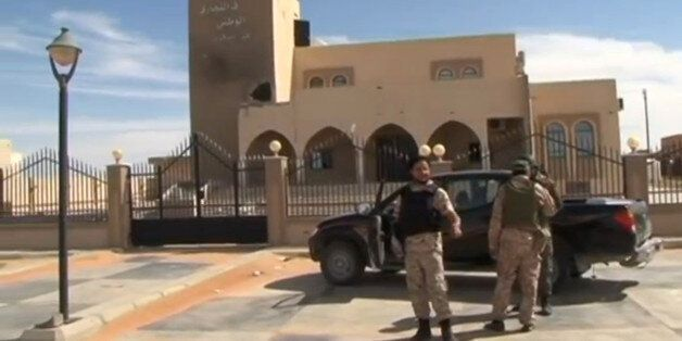 A still image from video released May 17, 2016 shows forces loyal to Libyan unity government outside...