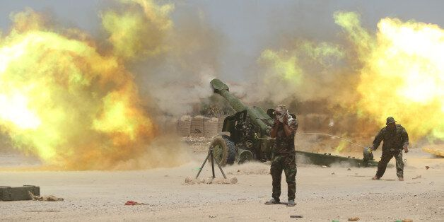 Shi'ite fighters fire artillery during clashes with Islamic State militants near Falluja, Iraq, May 29,...