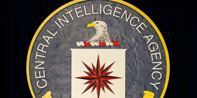 The CIA sign is seen onstage before the arrival of U.S. President Barack Obama to speak following a meeting...