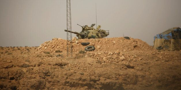A Tunisian security forces tank is seen through a car window at Dhiba by the Tunisian and Libyan border...