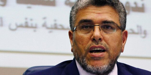 In this photo taken Thursday, Sept. 12, 2013, Moroccan Justice Minister Mustapha Ramid unveils a government...