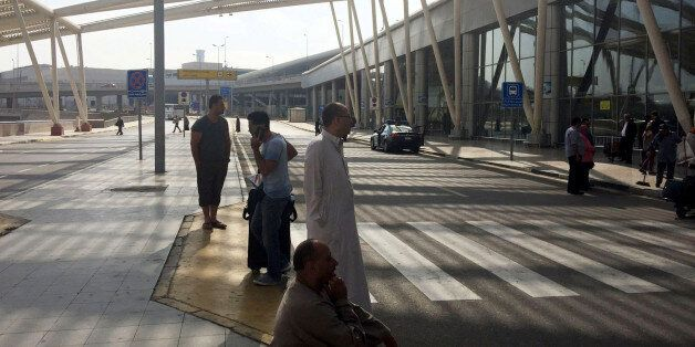 People wait outside the international arrivals terminal at Cairo Airport, Egypt May 19, 2016. REUTERS/Amr...