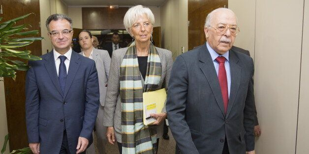 International Monetary Fund (IMF) Managing Director Christine Lagarde (C) meets with Tunisia's Central...