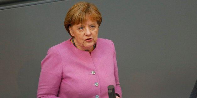 German Chancellor Angela Merkel addresses the lower house of parliament, Bundestag, in Berlin, Germany,...