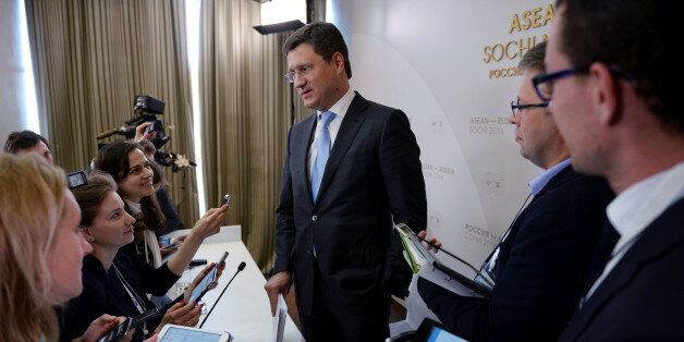 Russian Energy Minister Alexander Novak speaks to journalists following a news conference at the Russia-ASEAN...