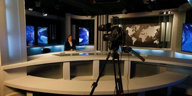 Nourelyakin Meghrich, an Ennahar TV News anchorwoman is seen at a TV news studio in Algier May 8, 2012....