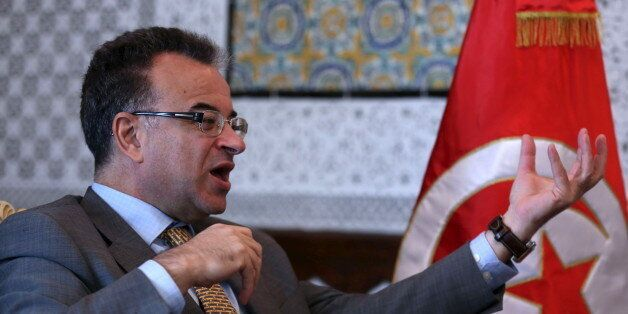 Tunisia's Finance Minister Slim Chaker gestures as he speaks with Reuters journalists in Tunis, Tunisia,...