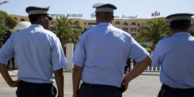 Tunisian policemen stand guard at the Riu Imperial Marhaba Hotel in Port el Kantaoui, on the outskirts...