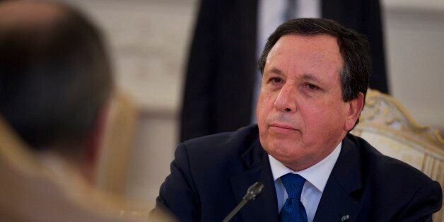 Tunisian Foreign Minister Khemaies Jhinaoui listens to his Russian counterpart Sergey Lavrov during their...