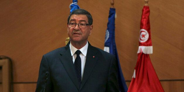 Tunisian Prime Minister Habib Essid speaks during the opening of the National Conference on Employment...