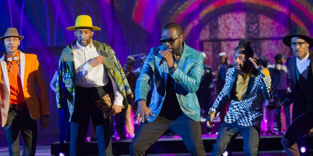 French rapper Gandhi Djuna aka Maitre Gims, center, performs on stage during the 31st Victoires de la...