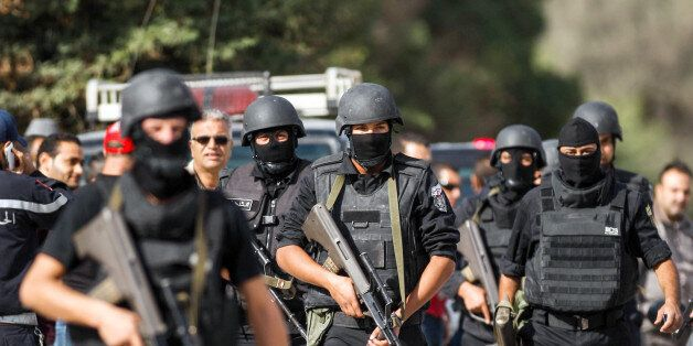 Members of the Tunisian National Guard take positions as they secure the scene of a shooting in the Oued...