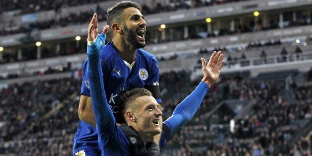 Jamie Vardy celebrates with Riyad Mahrez after scoring the first goal for Leicester City during their...