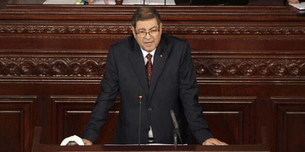 Tunisian prime minister Habib Essid delivers a speech the Assembly of People's Representatives after...