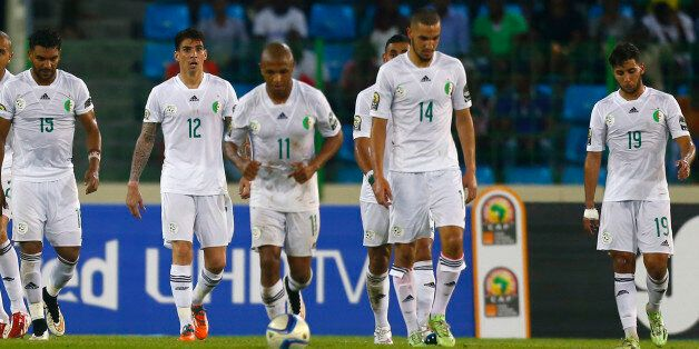 Algeria players react after a goal by Ivory Coast's Wilfried Bony (unseen) during their quarter-final...
