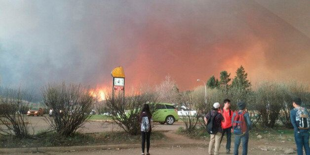 Students from Fort McMurray Composite High School are released early as wildfire burns nearby in Fort...