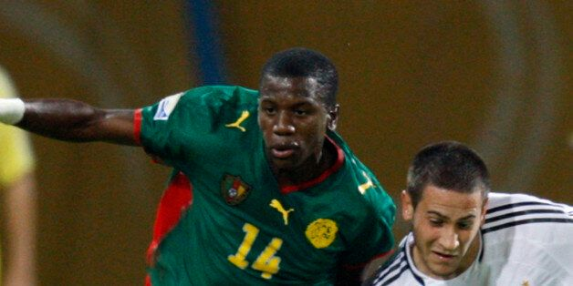 Mario Vrancic of Germany (R) challenges Patrick Ekeng of Cameroon (L) during their FIFA U-20 World Cup...