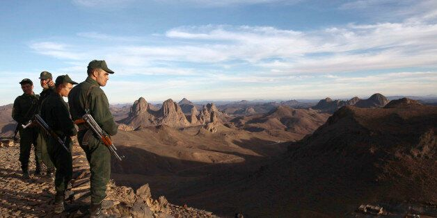 An Algerian Gendarme looks down from the top of the Askrem Mountain near Tamanrasset, some 2,000 km (1,243...