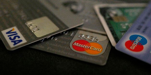 Bank debit and credit cards are photographed in this illustration picture at an office in Frankfurt,...