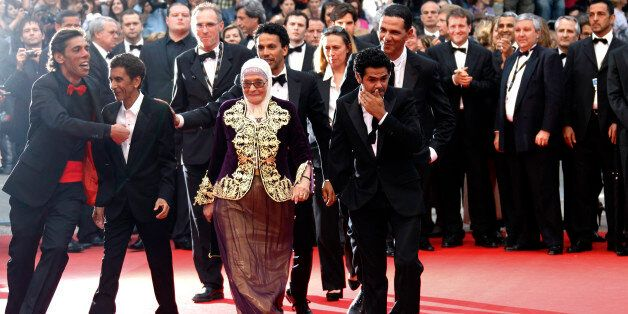 Director Rachid Bouchareb (2nd L) arrives on the red carpet with cast members Chafia Boudraa (C), Sami...
