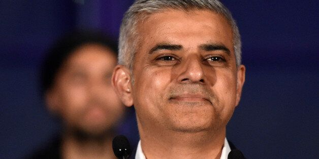 Sadiq Khan, Britain's Labour Party candidate for Mayor of London, smiles following his victory in the...