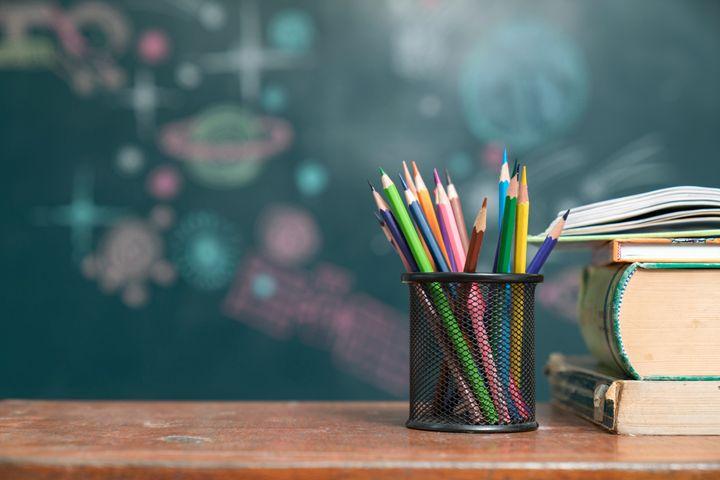 School books on desk, education concept(小学校のイメージ写真)