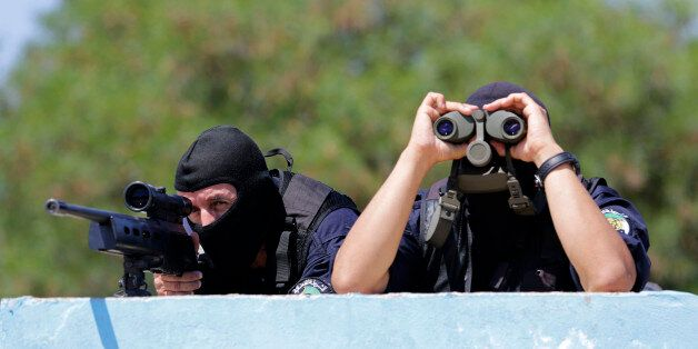 Members of Algeria's special police forces of Research and Intervention Brigade (BRI) take part in an...