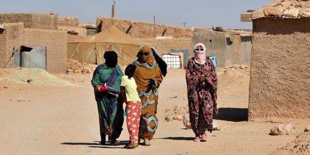 Sahrawi womenwalk through the Smara refugee camp near Tindouf, south-western Algeria, Friday, March 4,...
