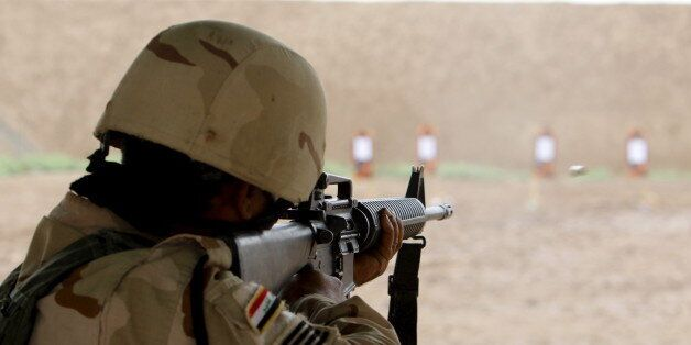 A member from Iraqi security forces takes part during a training session by coalition forces at Taji...