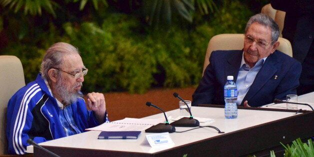 Cuba's former president Fidel Castro (L) sits next to his brother and Cuba's president Raul Castro during...