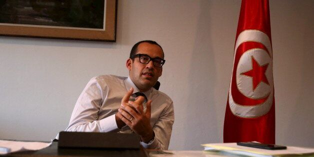 Tunisia's Investment Minister Yassine Brahim speaks with Reuters journalists in Tunis, Tunisia, October...