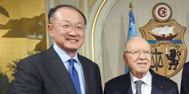 Tunisian President Beji Caid Essebsi (C), flanked by UN chief Ban Ki-moon (R) and World Bank chief Jim...